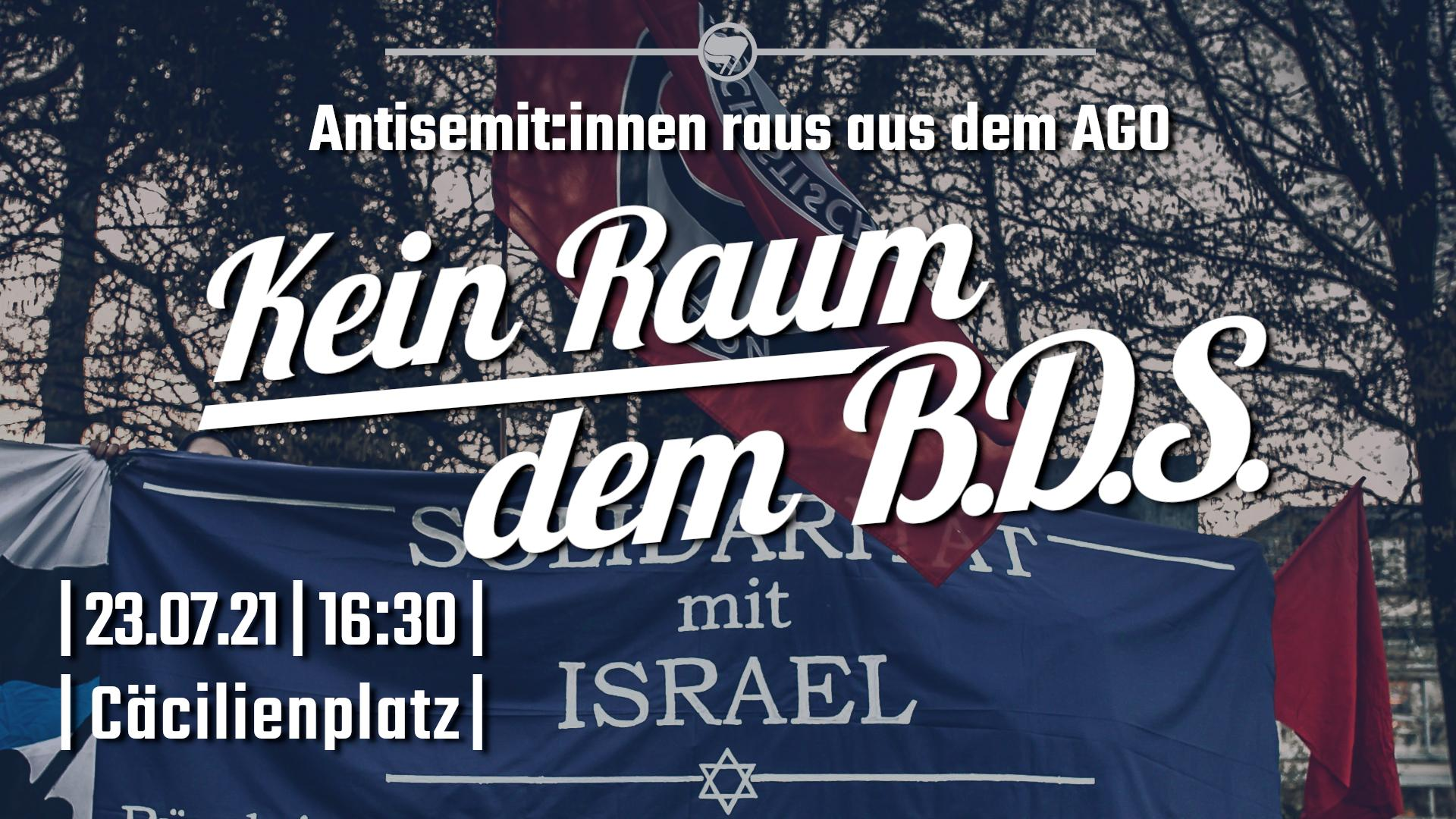 """Auf dem Bild ist ein blaues Transparent mit der Aufschrift """"Solidarität mit Israel"""", sowie mehrere Antifa-Fahnen zu sehen. Darüber steht der Text """"Antisemit:innen raus aus dem AGO - Kein Raum dem BDS"""" und """"23.07.21, 16:30 Uhr, Cäcilienplatz""""."""